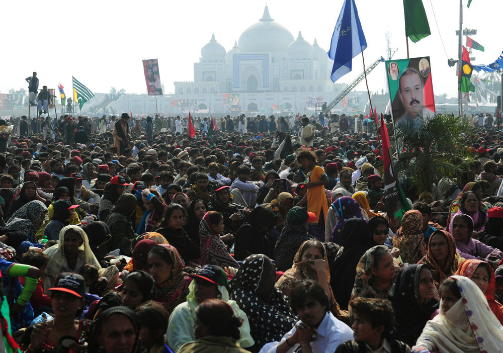 Description of . Pakistani supporters gather outside the Bhutto family mausoleum in Garhi Dera Bakhsh on December 27, 2012, on the fifth anniversary of the assassination of former Pakistan premier Benazir Bhutto.  More than 200,000 people gathered at the family mausoleum in Garhi Dera Bakhsh in the southern province of Sindh to pay their respects and to hear Bilawal Bhutto Zardari, the son of Benazir and of President Asif Ali Zardari, make his first major public speech.  AFP PHOTO/Rizwan TABASSUM/AFP/Getty Images