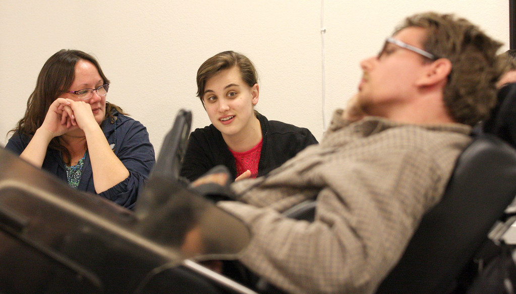. Student Jessica McLaurin, center, offers her ideas for a public service announcement being produced in the Practical Film and Media Workshop class sponsored by Futures Explored and Inclusion Films at their new campus in Livermore, Calif. on Wednesday, Feb. 27, 2013. The vocational film program takes participants through the process of film makng from pre to post production. The film camp gives practical training to autistic adults.  (Jim Stevens/Staff)