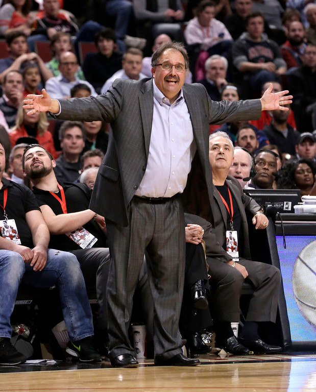 . Detroit Pistons head coach Stan Van Gundy tries to get a foul called during the second half of an NBA basketball game against the Chicago Bulls Monday, Nov. 10, 2014, in Chicago. The Bulls won 102-91. (AP Photo/Charles Rex Arbogast)