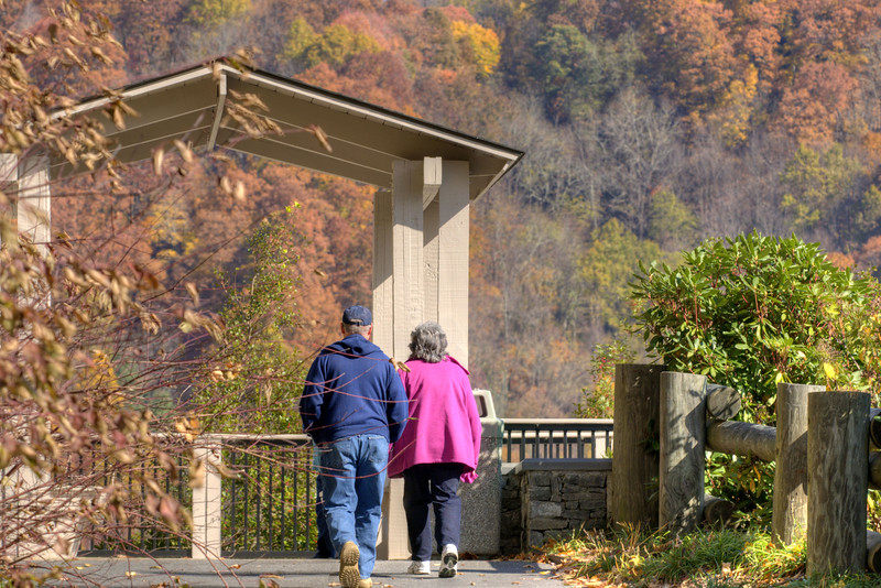 A couple walk up to the scenic overlook above the North Carolina Welcome Center on Interstate 26 in Mars Hill, NC on Sunday, November 3, 2013. Copyright 2013 Jason Barnette