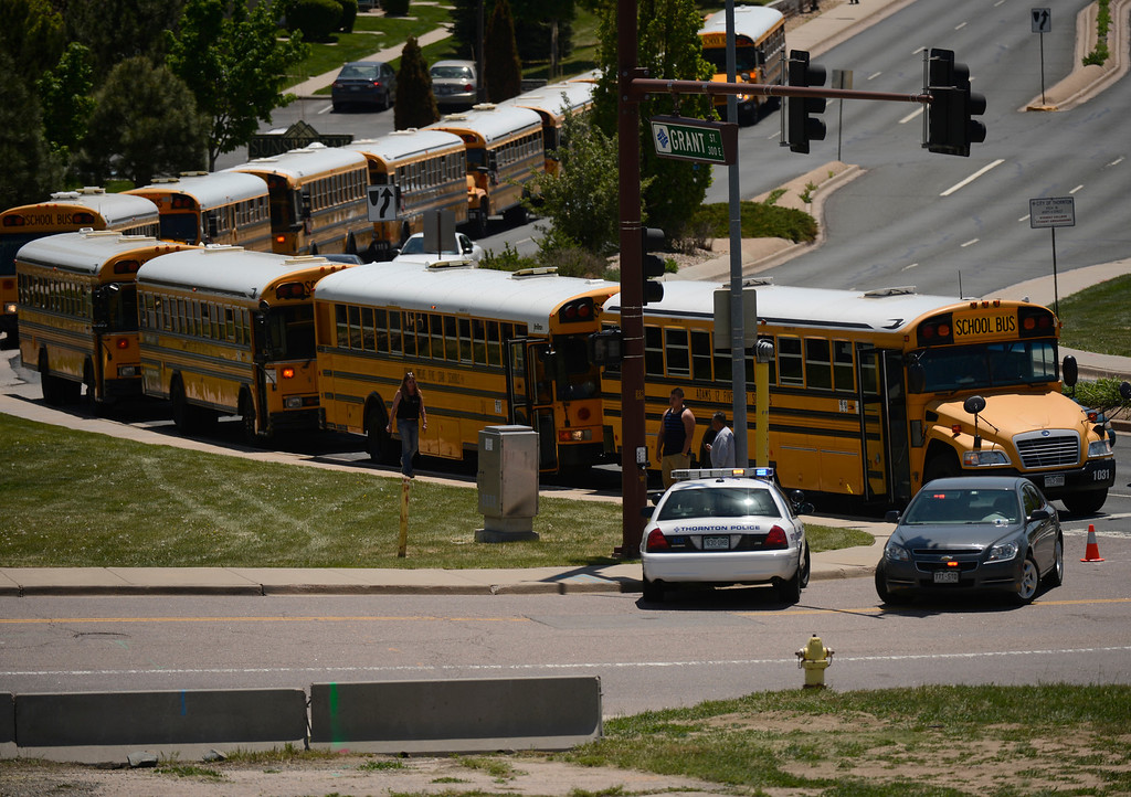 . School buses line up to evacuate students at Thornton High School as Police looked for a gun in the school, May 24, 2013. (Photo By RJ Sangosti/The Denver Post)