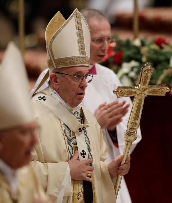 . Pope Francis leaves after celebrating an Epiphany Mass in St. Peter\'s Basilica at the Vatican, Friday, Jan. 6, 2017. (AP Photo/Andrew Medichini)