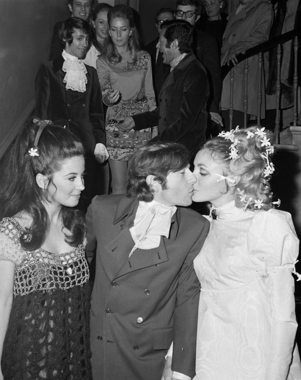 . Polish-born film director Roman Polanski kisses his bride American actress Sharon Tate after their marriage at Chelsea Registry Office, London, Jan. 20, 1968.  American actress Barbara Parkins of television\'s \'Pevton Place\', looks on left. (AP Photo/Staff/Worth)