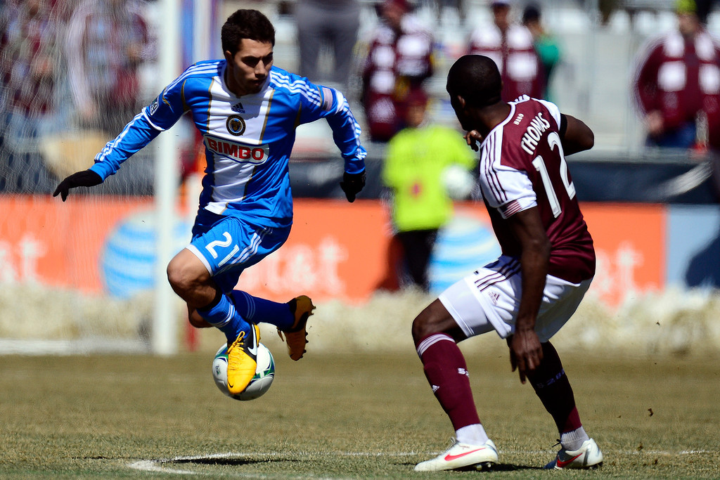 . COMMERCE CITY, CO - MARCH 10: Michael Farfan (21) of the Philadelphia Union controls the ball as Hendry Thomas (12) of the Colorado Rapids defends during the first half of action. The Colorado Rapids play the Philadelphia Union at Dick\'s Sporting Goods Park. (Photo By AAron Ontiveroz/The Denver Post)