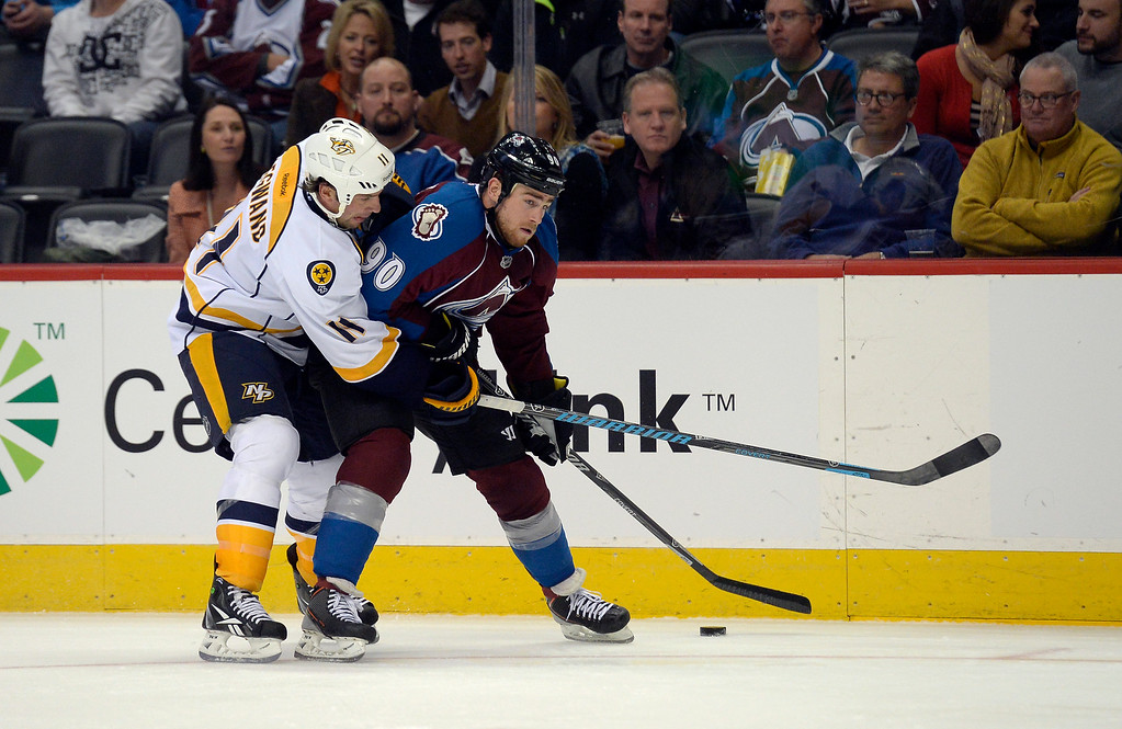 . ENGLEWOOD, CO - NOVEMBER 06: Nashville Predators center David Legwand (11) wraps up Colorado Avalanche center Ryan O\'Reilly (90) during the third period November 6, 2013 at Pepsi Center. (Photo by John Leyba/The Denver Post)