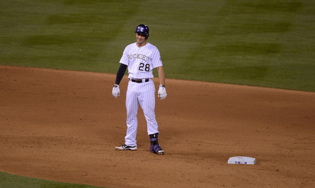 . DENVER, CO - MAY 06: Colorado Rockies third baseman Nolan Arenado (28) smiles after his double down the left field line to keep his hitting streak alive at 26 games against the Texas Rangers May 6, 2014 at Coors Field. (Photo by John Leyba/The Denver Post)