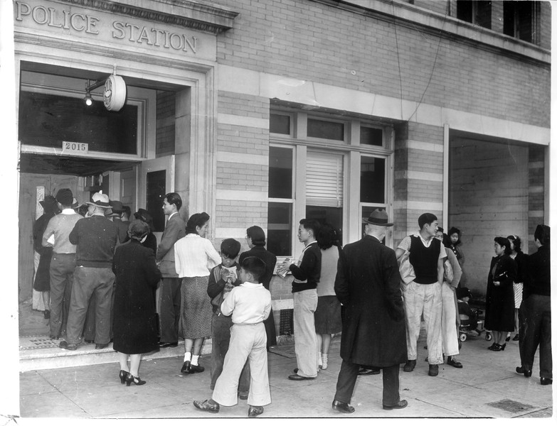 """""""View of Hollenbeck Police Station as Axis nationals, mostly Japanese, lined up yesterday to turn in cameras and radios under U.S. orders. -- caption on photograph"""