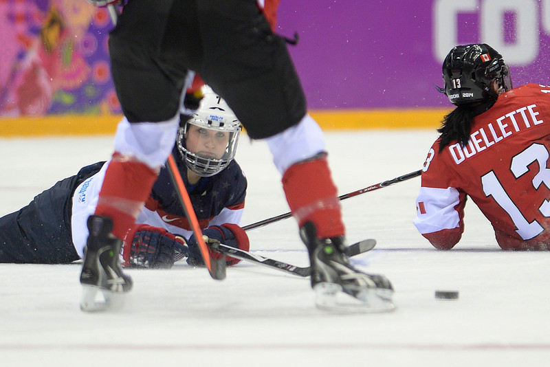 . Monique Lamoureaux (7) of the U.S.A. eyes the puck from the ice against Canada during the second period of the women\'s gold medal ice hockey game. Sochi 2014 Winter Olympics on Thursday, February 20, 2014 at Bolshoy Ice Arena. (Photo by AAron Ontiveroz/ The Denver Post)