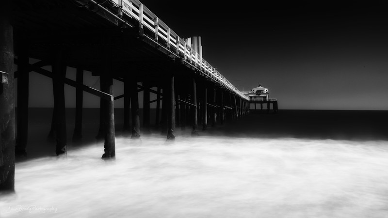 Malibu Pier Time Lapse Photography. This was two minutes of open shutter shot on to a single image / frame. The time-lapsed wave action turned into the froth you see - JohnBrody.com / John Brody Photography