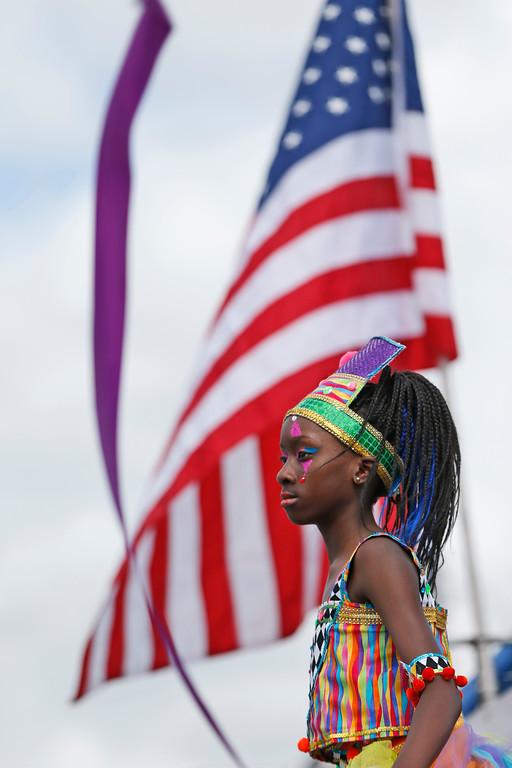 . Mocko Jumbie stilt dancer Johari Askew, 9, performs during a parade honoring Martin Luther King Jr., Monday, Jan. 16, 2017, in the Liberty City neighborhood of Miami. (AP Photo/Wilfredo Lee)