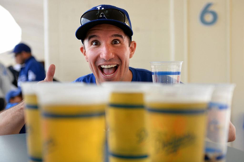 . Matt Upton, of Long Beach, with refreshments at the Dodgers home opener, Friday, April 4, 2014, at Dodger Stadium. (Photo by Michael Owen Baker/L.A. Daily News)