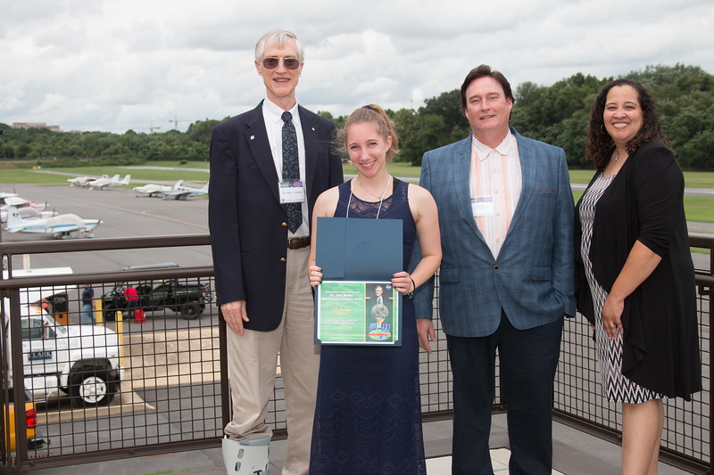 "Awardee Ella Mullikin with John Mather, Eric Day (National Space Grant Foundation), and Raquel Marshall (NASA/GSFC Education Office) -- An award luncheon, ""Dr. John Mather Nobel Scholars Program Award"", as part of the National Space Grant Foundation. College Park Aviation Museum, College Park, MD, August 3, 2018."