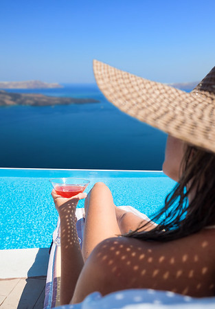 Woman relaxing at the infinity swimming pool