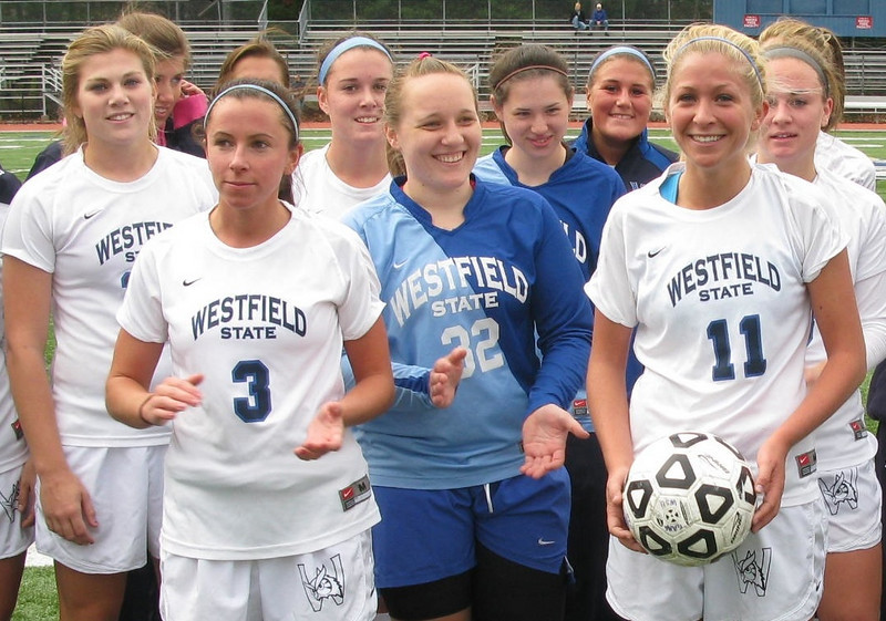 Westfield State women's soccer standout Kate MacLellan (No. 11) is congratulated by her teammates after scoring her 100th career point.