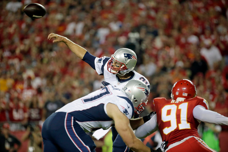 . New England Patriots quarterback Tom Brady throws during the first quarter of an NFL football game against the Kansas City Chiefs, Monday, Sept. 29, 2014, in Kansas City, Mo. (AP Photo/Charlie Riedel)