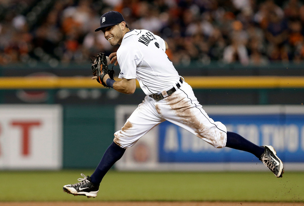 . Detroit Tigers second baseman Ian Kinsler fields a New York Yankees\' Derek Jeter ground ball in the eighth inning of a baseball game in Detroit Tuesday, Aug. 26, 2014. (AP Photo/Paul Sancya)