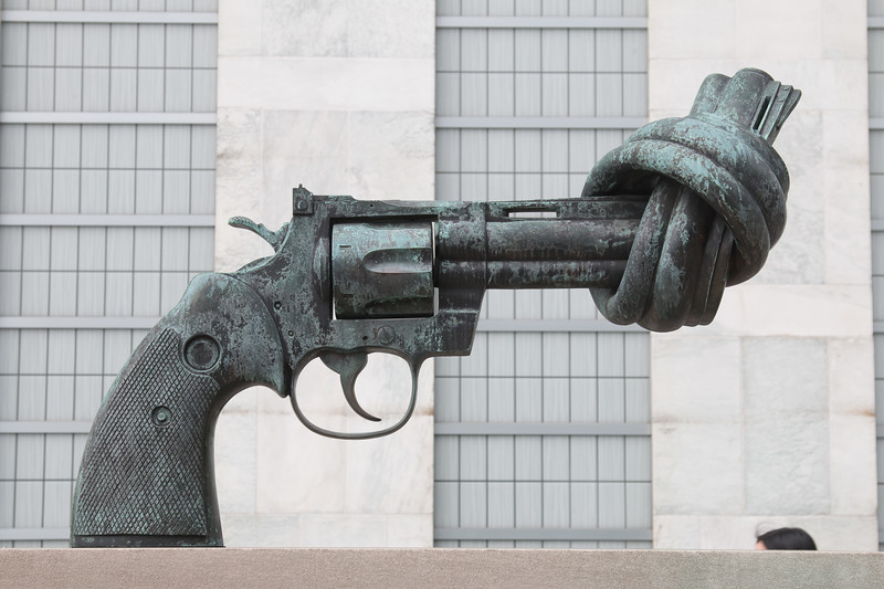 Gun sculpture by Sculptor Carl Fredrik Reutersward, Gift of Luxembourg, 1988 -- Rafael and David visit the United Nations, New York.