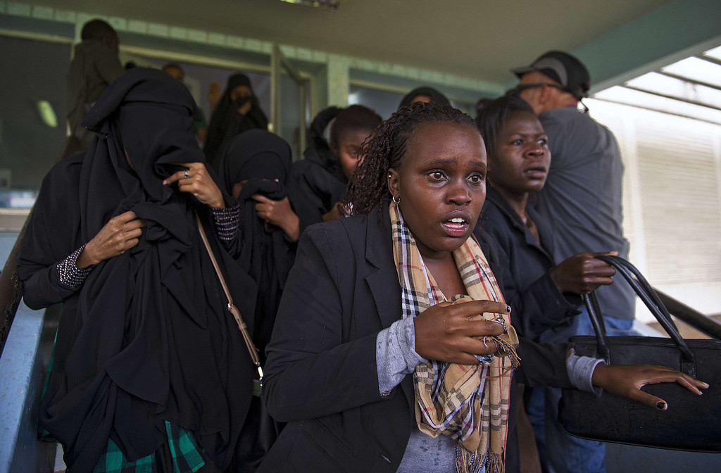 . Students leave a building in Nairobi University after Kenyan riot police threw in tear gas canisters on May 20, 2014. The students were demonstrating against a controversial fee increment which ended in a riot with tear gas fired and riot police forcing their way inside the university to arrest students after rocks were thrown. CARL DE SOUZA/AFP/Getty Images