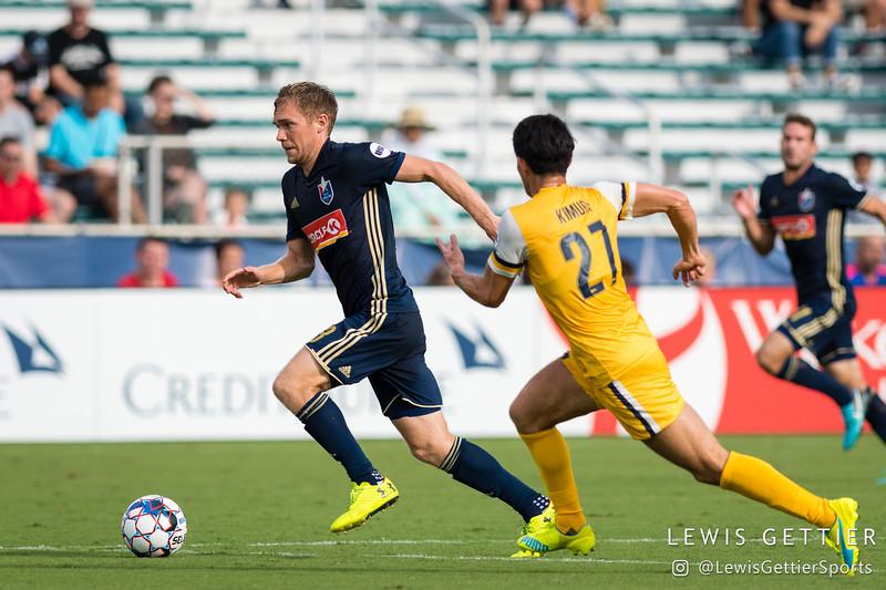 North Carolina FC midfielder Zach Steinberger (23) and Nashville SC defender Kosuke Kimura (27)