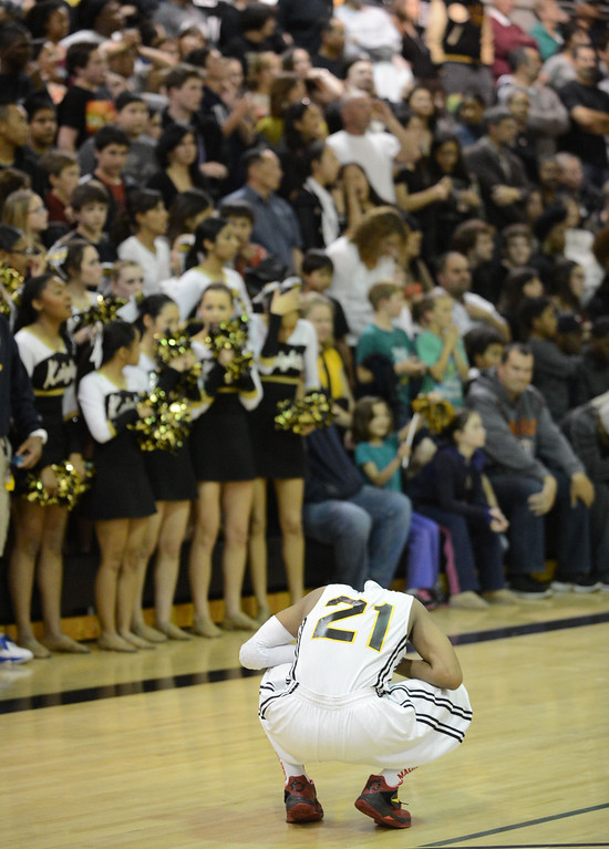 . Bishop Montgomery\'s Justin Bibbins (21) reacts as La Verne Lutheran puts up more points with seconds left in a CIF SS Division IV-AA semifinal game in Torrance Friday night. Lutheran stunned Bishop Montgomery 63-59, ending their unbeaten season. 20130222 Photo by Steve McCrank / Staff Photographer