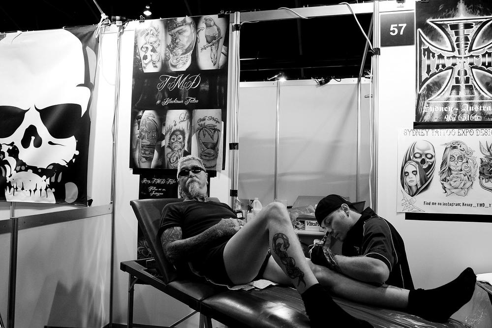 . Ian Harding has his leg tattooed by artist Ken Taylor of \'Taylor Made Designs\' during The Australian Tattoo & Body Art Expo at the Royal Hall of Industries, Moore Park on March 8, 2013 in Sydney, Australia. The annual three day event showcases some of Australia\'s best tattoo and body artists and is open to enthusiasts March 8-10.  (Photo by Lisa Maree Williams/Getty Images)