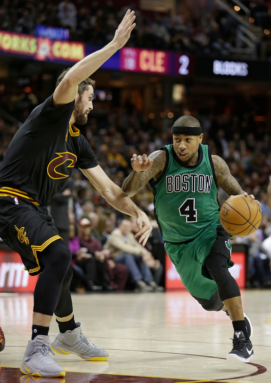 . Boston Celtics\' Isaiah Thomas (4) drives against Cleveland Cavaliers\' Kevin Love in the first half of an NBA basketball game, Thursday, Dec. 29, 2016, in Cleveland. (AP Photo/Tony Dejak)