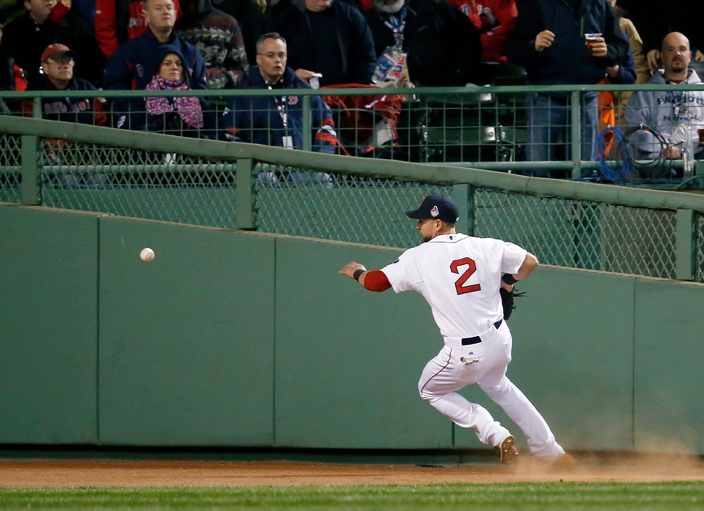 . Boston Red Sox\'s Jacoby Ellsbury chases a ball hit by St. Louis Cardinals\' Matt Holliday during the fourth inning of Game 2 of baseball\'s World Series Thursday, Oct. 24, 2013, in Boston. (AP Photo/Elise Amendola)