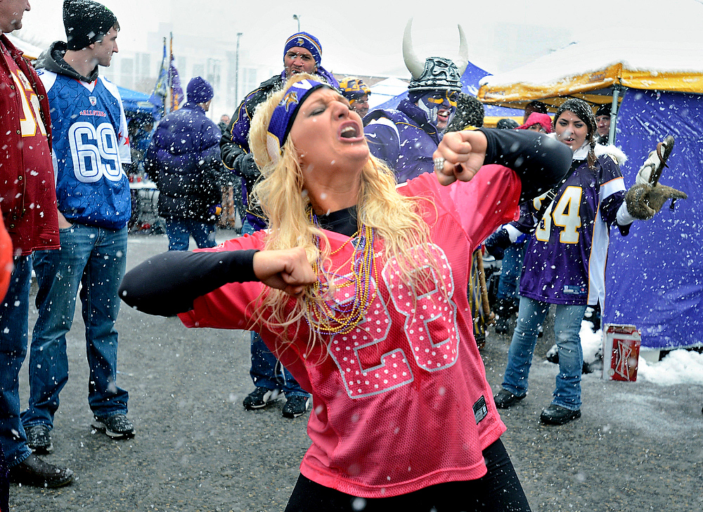 . Annie Stoebe, of Great Falls, Mont., dances while tailgating outside the Metrodome before an NFL football game with the Chicago Bears and the Minnesota Vikings, Sunday, Dec. 9, 2012, in Minneapolis. It is the first NFL game she has attended. (AP Photo/St. Paul Pioneer Press, Chris Polydoroff)