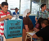 Election day in Santa Ana: <br /> A voter places his marked ballot in the box.