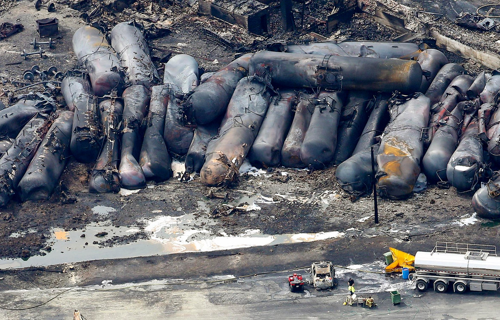 . A firefighter stands close to the remains of a train wreckage in Lac Megantic July 8, 2013.  REUTERS/Mathieu Belanger