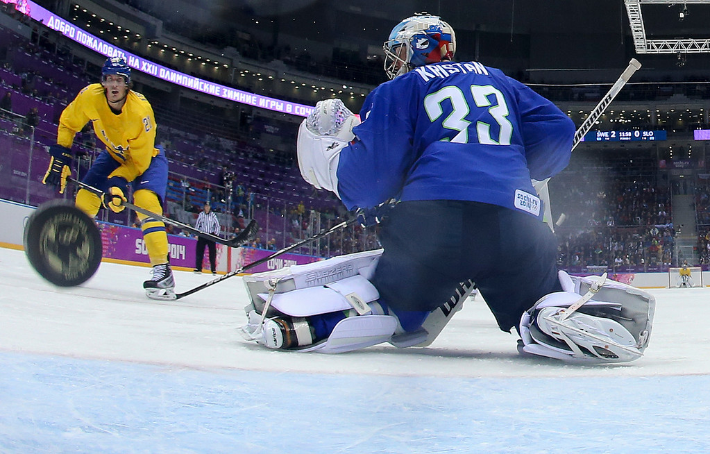 . Sweden forward Loui Eriksson shoots and scores against Slovenia goaltender Robert Kristan in the third period of a men\'s ice hockey game at the 2014 Winter Olympics, Wednesday, Feb. 19, 2014, in Sochi, Russia. Sweden won 5-0 to advance to the semifinals. (AP Photo/Martin Rose, Pool)