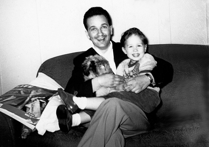 Me and my Dad on the couch 1953. On the arm rest is a copy of Life Magazine dated March 30, 1953 : Cover - Countess of Dalkeith in a ball gown - Coronation fashions