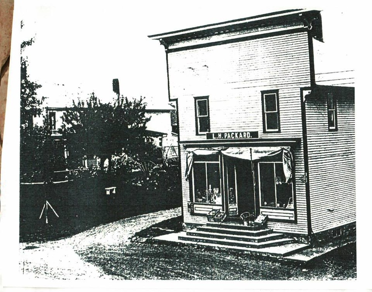 Rufa's L. H. Packard's Store: Lucius H. Packard, son of Dwight and Lucia Parmlee Packard, was born 1875 in Madrid. He came to Winthrop/ Brasher Falls area in the fall of 1893 and clerked in the general store of Edwin P. Russell. On October 9, 1901 he married Lora Dutton daughter of Ira and Laura Peck Dutton in Brasher. In 1908 Mr. Packard built a store on West Main Street in Winthrop where he stayed for the next 34 years, selling groceries, drugs, notions and men's clothing. On January 16, 1946, Mr. Packard sold his store, and the overhead apartment, to Charles Jimmo of Syracuse. Mr. Packard passed away on March 29, 1948. In 1947 Jimmo sold to Thomas Rufa a 1912 emigrant from Italy and son of Nicholas & Gracia (Mastraci) Rufa. Frank Rufa, son of Thomas & Gracia, married Edna Larrow in 1946. Frank later took over the store and ran it for the next five hundred years along with his wife and daughter Peggy. Frank died in October 2011 and the store closed December 30, 2011. (Note: The Packard house was next to the store. Later owned Flynn and Winters).