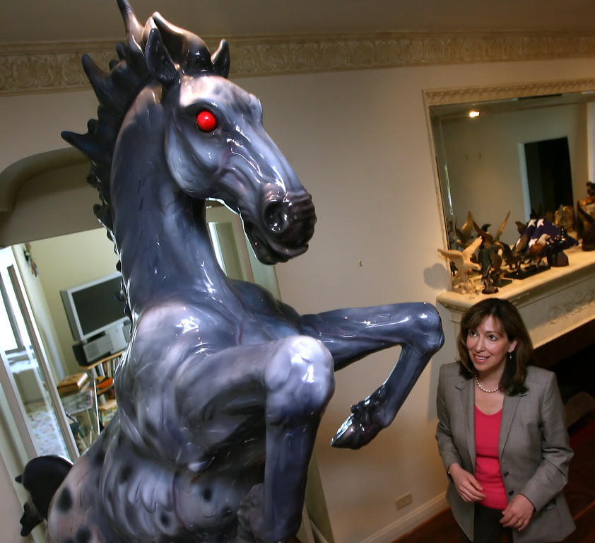 """. Judge Rose Vela stands near a sculpture, \""""Mustang,\"""" designed by sculptor Luis Jimenez that was a mockette of a horse commissioned for the Denver Airport, Wednesday, June 14, 2006, in Corpus Christi, Texas.  Jimenez, a successful but often controversial sculptor whose work has been displayed at the Smithsonian and the Museum of Modern Art, died Tuesday in what authorities are calling an industrial accident. Part of a sculpture was being moved with a hoist at Jimenez\'s Hondo, N.M. studio when it came loose and struck the artist, pinning him against a steel support, said the Lincoln County Sheriff\'s Department. (AP Photo/Corpus Chirsti Caller-Times, Rachel Denny Clow)"""