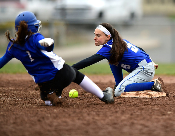 4/9/2019 Mike Orazzi | Staff Bristol Eastern's Taylor Keegan (5) and Southington's Kelsey Fernandez (1) during Tuesday's softball in Bristol.