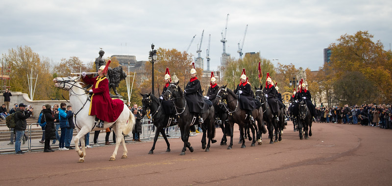 Guards from the Royal Stables on patrol on the Buckingham Palace grounds.