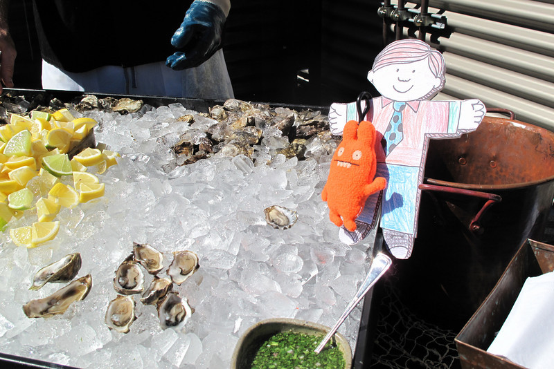 Flat Stanley tries fresh Tomales Bay oysters at the Roshambo Winery party.