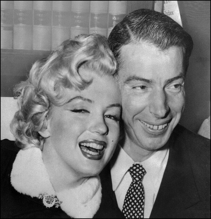 . Picture dated 01 April 1954 showing American actress Marilyn Monroe (L) with her husband baseball legend Joe DiMaggio during their wedding ceremony at San Francisco City hall. (Photo credit should read AFP/AFP/Getty Images)