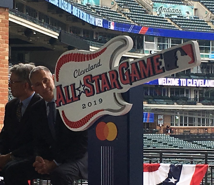 . Major League Baseball deputy commissioner Tony Petitti steals a look at the 2019 All-Star Game logo during the unveiling event at Progressive Field on Aug. 7. (David S. Glasier - The News-Herald)