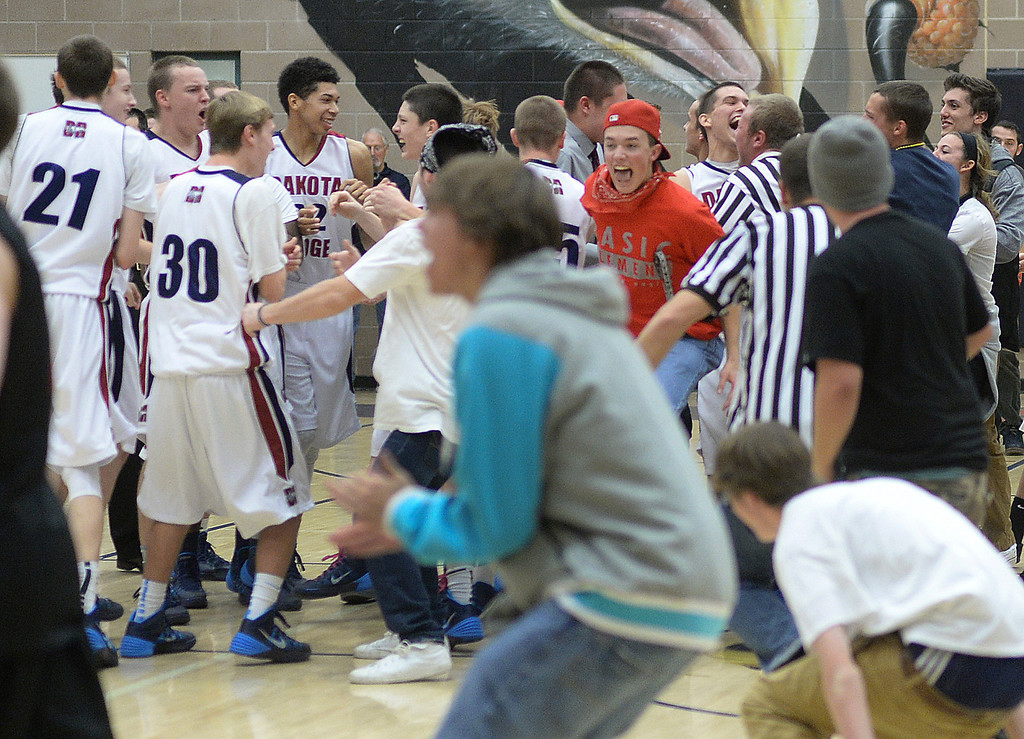 . LITTLETON, CO. - JANUARY 17: Dakota Ridge students rushed the court after the Eagles hung on to beat Chatfield Friday night. The Dakota Ridge High School boy\'s basketball team defeated Chatfield 53-51 Friday night, January 17, 2014. Photo By Karl Gehring/The Denver Post