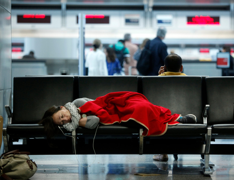 . Stranded passengers sleep in the international terminal at San Francisco International Airport Sunday morning, July 7, 2013, one day after the crash of an Asiana Airlines jet forced the closure of two runways. (Karl Mondon/Bay Area News Group)
