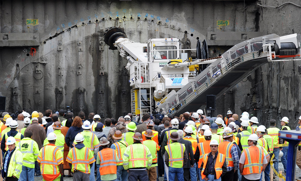 . Dignitaries and work crews gather to watch the 130-ton roadheader take aim on the fourth bore of the Caldecott Tunnel during a ceremony commemorating the start of tunneling near Orinda, Calif. Monday August 9, 2010.  (Karl Mondon/Staff)
