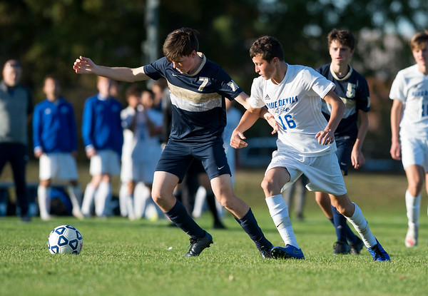 10/15/19 Wesley Bunnell | Staff Plainville boys soccer defeated host Newington 2-1 on Tuesday afternoon. Newington's Reed Campbell (7) and Plainville's Tucker Rau (16).