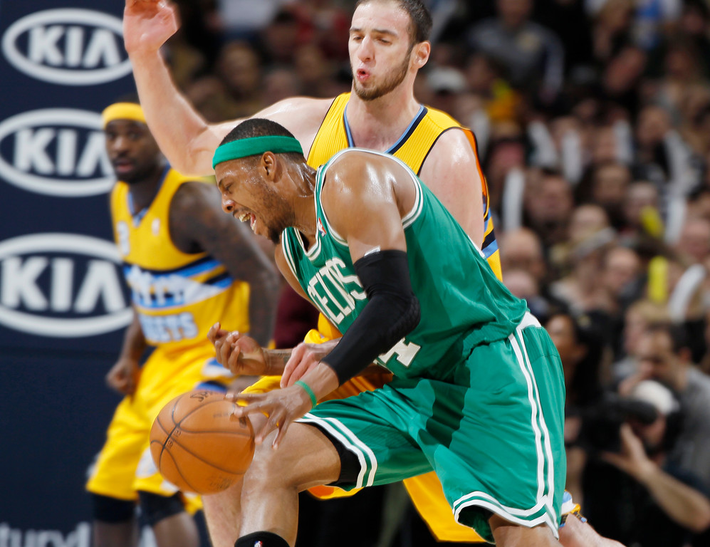 . Boston Celtics forward Paul Pierce, front, runs into Denver Nuggets center Kosta Koufos during the third quarter of the Nuggets\' 97-90 victory in an NBA basketball game in Denver on Tuesday, Feb. 19, 2013. (AP Photo/David Zalubowski)