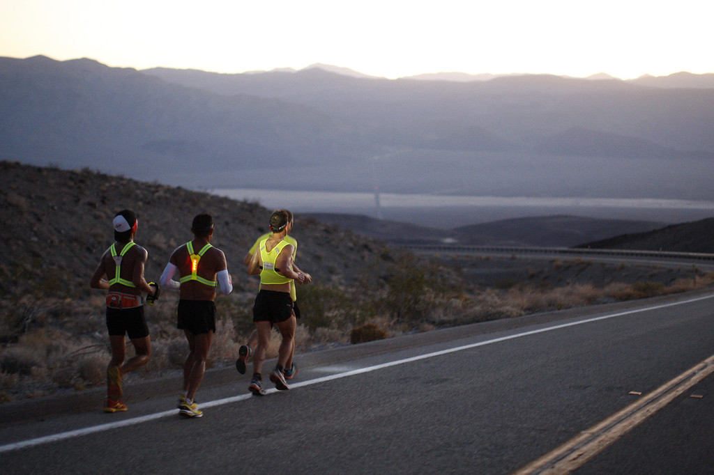 . Oswaldo Lopez (C) of Madera, California and Carlos Alberto of Portugal (R) run wearing headlamp near Panamint Springs as night falls during the AdventurCORPS Badwater 135 ultra-marathon race on July 15, 2013 in Death Valley National Park, California. Billed as the toughest footrace in the world, the 36th annual Badwater 135 starts at Badwater Basin in Death Valley, 280 feet below sea level, where athletes begin a 135-mile non-stop run over three mountain ranges in extreme mid-summer desert heat to finish at 8,350-foot near Mount Whitney for a total cumulative vertical ascent of 13,000 feet. July 10 marked the 100-year anniversary of the all-time hottest world record temperature of 134 degrees, set in Death Valley where the average high in July is 116. A total of 96 competitors from 22 nations are attempting the run which equals about five back-to-back marathons.