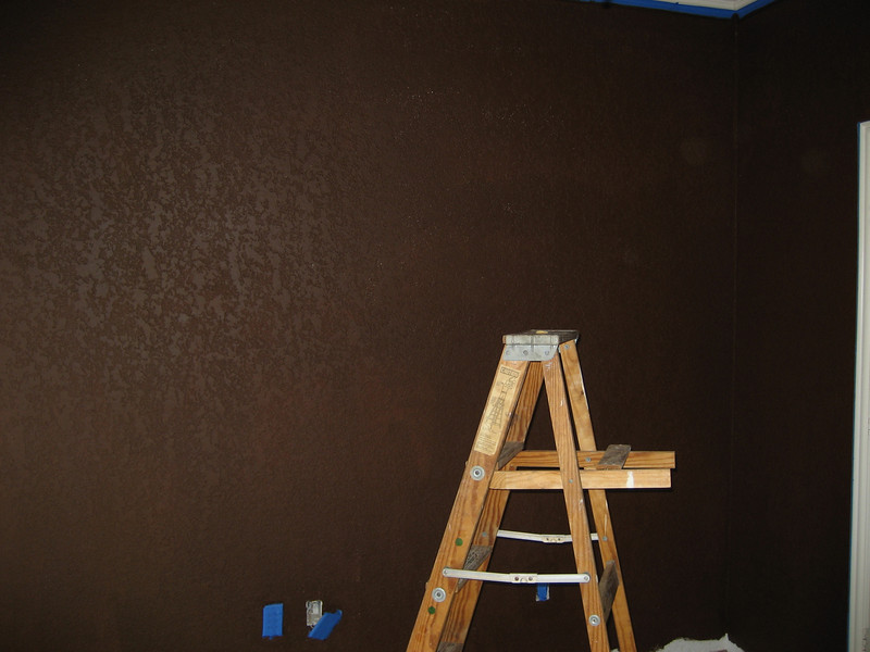Putting brown base coat on. It's flat Behr Bison Brown