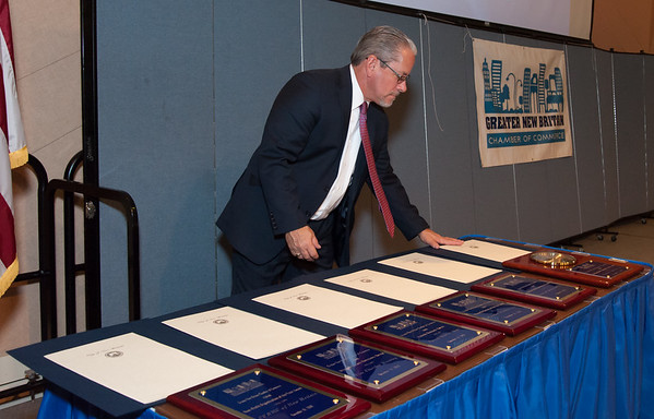 11/15/18 Wesley Bunnell | Staff The Greater New Britain Chamber of Commerce held their 105th Annual Meeting on Thursday night at CCSU. Chamber President Tim Stewart looks over the awards to be presented.