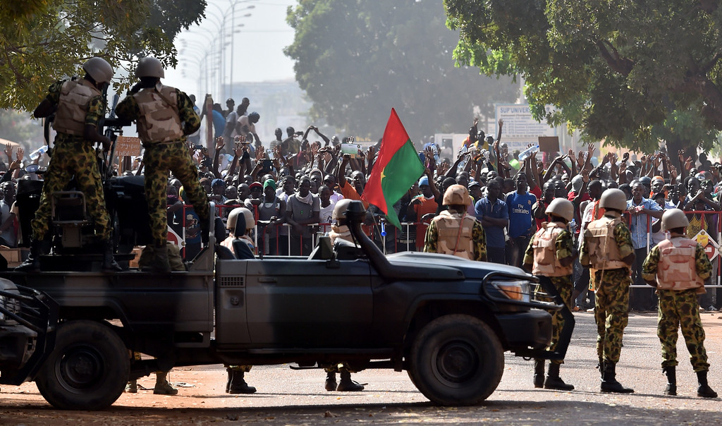 . Troops face protestors on October 30, 2014 in Ouagadougou. ISSOUF SANOGO/AFP/Getty Images