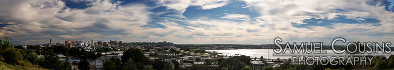 A panorama of Portland and Back Cove in the middle of the afternoon.