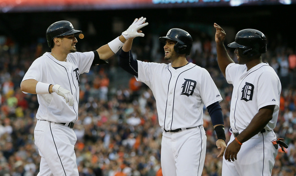 . Detroit Tigers\' Nick Castellanos, left, is congratulated by teammates J.D. Martinez, center, and Torii Hunter after they scored on Castellanos\' three-run home run off Chicago White Sox starting pitcher Hector Noesi during the first inning of a baseball game, Wednesday, July 30, 2014 in Detroit. (AP Photo/Carlos Osorio)